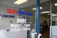 Sunsigns - door showing hours of operation Monday-Friday 9:00am-5:00pm